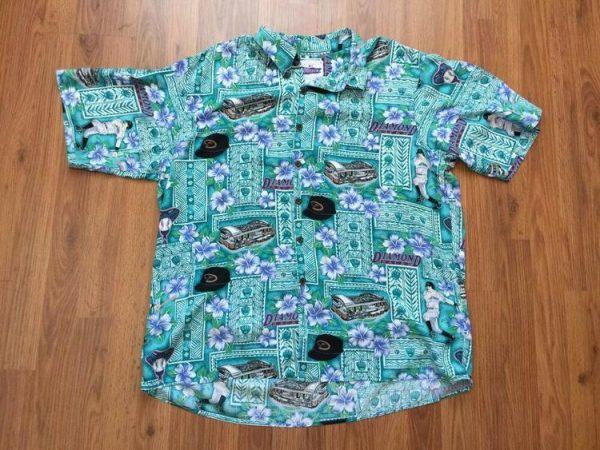 printer collared Aloha shirt on wood background